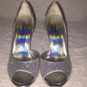 CityCLASSIFIED Silver Heels, size 7.